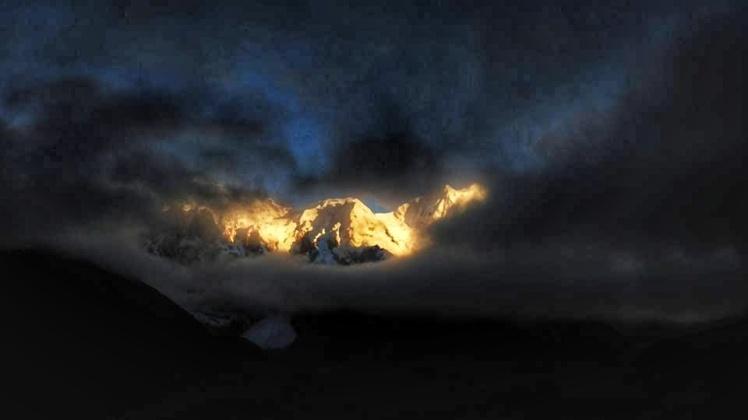 A Golden Sunrise Over The Mount Kanchenjunga