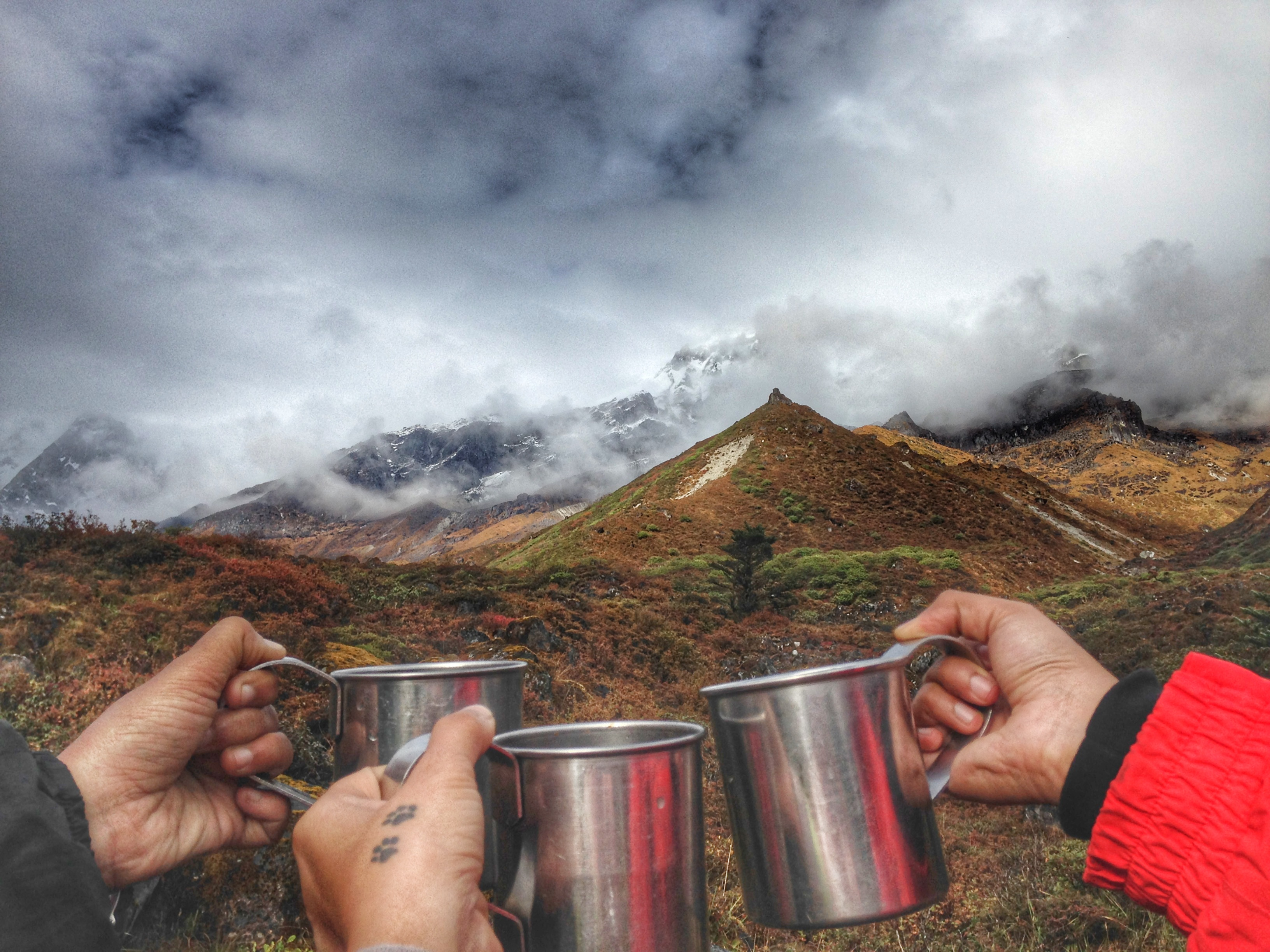 Chai in the mountains against a stunning backdrop: Goechala Trek